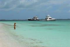 Girl,yacht and Caribbean sea Stock Photography