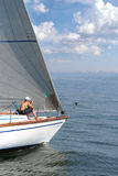 Girl on yacht desc. Girl sitting on yacht desc and going into the sea Stock Photo
