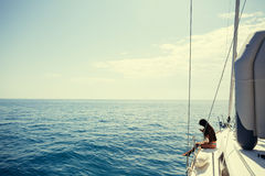 Girl yachting with smartphone photograph cruise Stock Photography