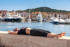 Girl and yachts on the coast of Saint Tropez Stock Photography