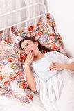 Girl yawn in a bed Stock Photo