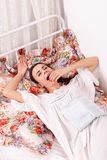 Girl yawn in a bed Stock Image