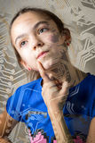 Girl. 11 year old girl looks thoughtfully through the silhouette of a computer motherboard, leaning a finger to her cheek. the concept of a new technological Royalty Free Stock Photo