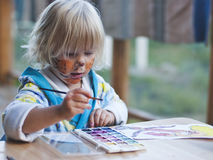 The girl of 3 years  draws paints Stock Image