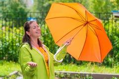 Girl 30 years enjoying the sun after rain Royalty Free Stock Photos