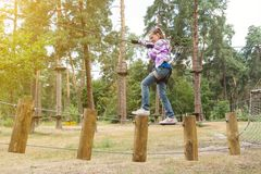 The girl is 10 years old in adventure climbing high wire park, active lifestyle of children royalty free stock photo