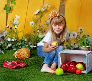 Girl 6 years old in garden with apples Stock Image