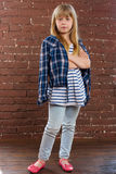 Girl 6 years old in jeans and shirt is thrown Royalty Free Stock Image