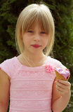Girl 6 years old in a pink dress with ice cream Stock Photo