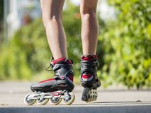 Young woman skating with a rollerblades stock images