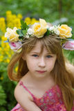 Girl 6 years old a wreath in the meadow Stock Image