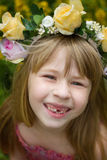 Girl 6 years old in wreath. Smiles. Baby teeth fall out. Stock Photo