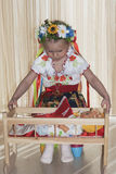 The girl of 4 years stacks the doll in a bed Royalty Free Stock Photography
