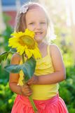 Girl years of sunflower royalty free stock photography
