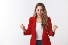 Girl yelling happiness, clenching fists victory celebrating success smiling broadly close eyes achieve goal, winning. Victory good news lucky opportunity royalty free stock images