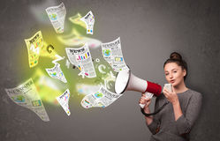 Girl yelling into loudspeaker and newspapers fly out Stock Photos