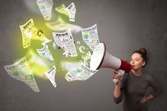 Girl yelling into loudspeaker and newspapers fly out Royalty Free Stock Photo