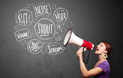 Girl yelling into megaphone and hand drawn speech bubbles come o Royalty Free Stock Photos