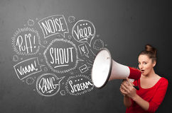 Girl yelling into megaphone and hand drawn speech bubbles come o Stock Image