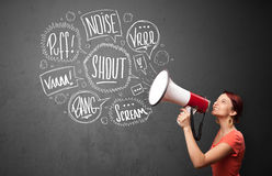 Girl yelling into megaphone and hand drawn speech bubbles come o Stock Photo
