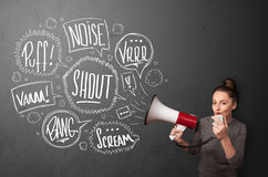 Girl yelling into megaphone and hand drawn speech bubbles come o Stock Images
