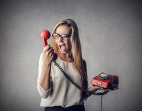 Girl yelling at the phone Royalty Free Stock Image