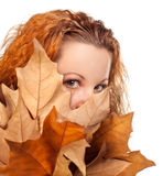 Girl with yellow autumn leaves Royalty Free Stock Image