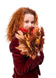 Girl with yellow autumn leaves Royalty Free Stock Photos