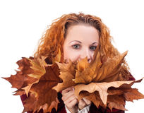 Girl with yellow autumn leaves Royalty Free Stock Images