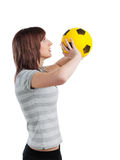 Girl with yellow ball Royalty Free Stock Images