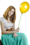 A girl with a yellow balloon Royalty Free Stock Photos