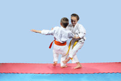 Girl with yellow belt makes slicing down under leg Royalty Free Stock Image
