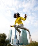 Girl in a yellow blazer jumping Royalty Free Stock Photos