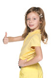 Girl in yellow blouse holds her thumb up Royalty Free Stock Photography