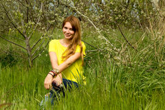 Girl in yellow blouse Stock Images