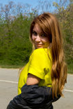Girl in yellow blouse Royalty Free Stock Photo