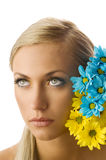 Girl and yellow and blue flower Stock Image