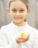 girl with yellow chicken Stock Photo