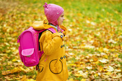 Girl in yellow coat and pink Stock Image