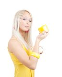 Girl with yellow cosmetic container. Isolated on white stock photo