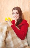 Girl with a yellow cup Royalty Free Stock Image