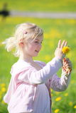 Girl with yellow dandelion Stock Image