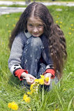 Girl and yellow dandelions Stock Photos