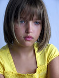 Girl with yellow dress. Girl portrait with blue eyse and yellow dress Stock Image