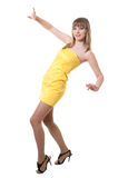 Girl in yellow dress Stock Images