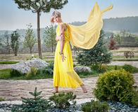 The girl  in a yellow dress Royalty Free Stock Photo