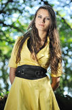 A girl with a yellow dress. Stock Images