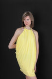 Girl in a yellow dress Stock Photos