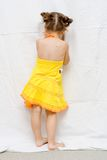 Girl in yellow dress Stock Photos