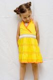 Girl in yellow dress Royalty Free Stock Photography
